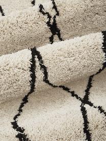 Pluizig hoogpolig vloerkleed Nouria, handgetuft, Bovenzijde: 100% polyester, Onderzijde: 100% katoen, Beige, zwart, 200 x 300 cm
