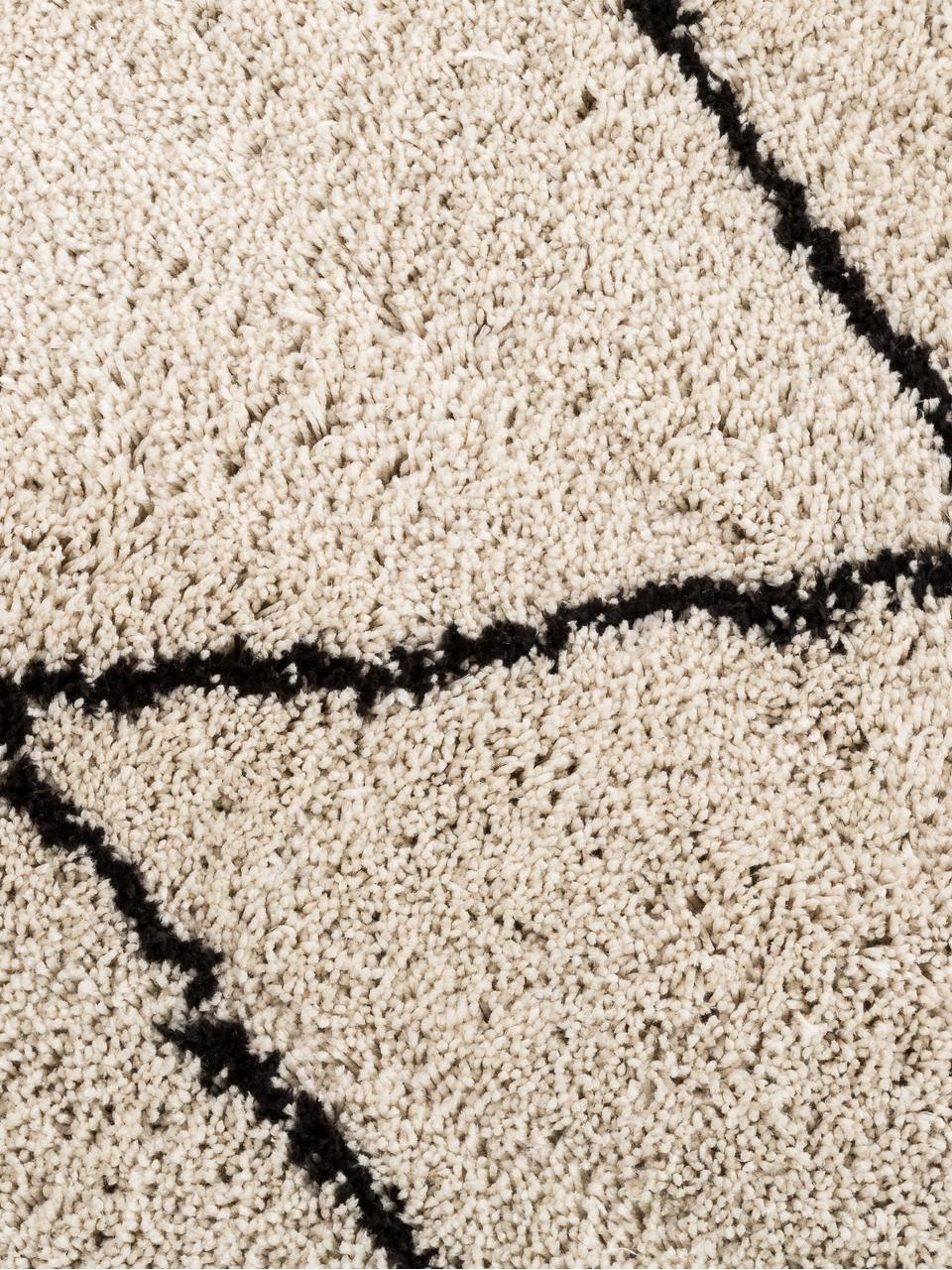 Puszysty ręcznie tuftowany z wysokim stosem dywan Nouria, Beżowy, czarny, S 200 x D 300 cm