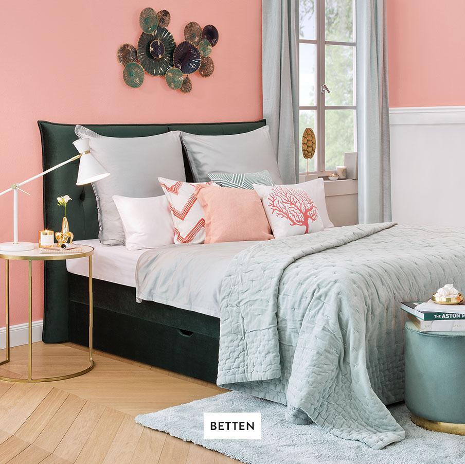 Schlafzimmer-Betten-Kissen-Teppich