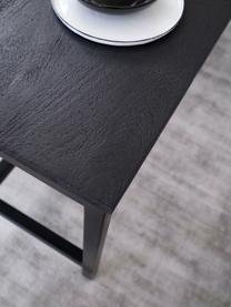 Stół do jadalni z blatem z litego drewna Raw, Blat: lite drewno mangowe, szcz, Stelaż: metal malowany proszkowo, Blat: drewno mangowe, czarny, lakierowany Stelaż: czarny, matowy, S 180 x G 90 cm
