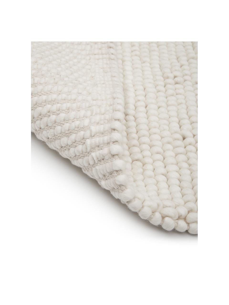 Wollen vloerkleed Pebble in crèmewit, 80% Nieuw-Zeelandse wol, 20% nylon Bij wollen vloerkleden kunnen vezels loskomen in de eerste weken van gebruik, dit neemt af door dagelijks gebruik en pluizen wordt verminderd., Wit, B 80 x L 150 cm (maat XS)
