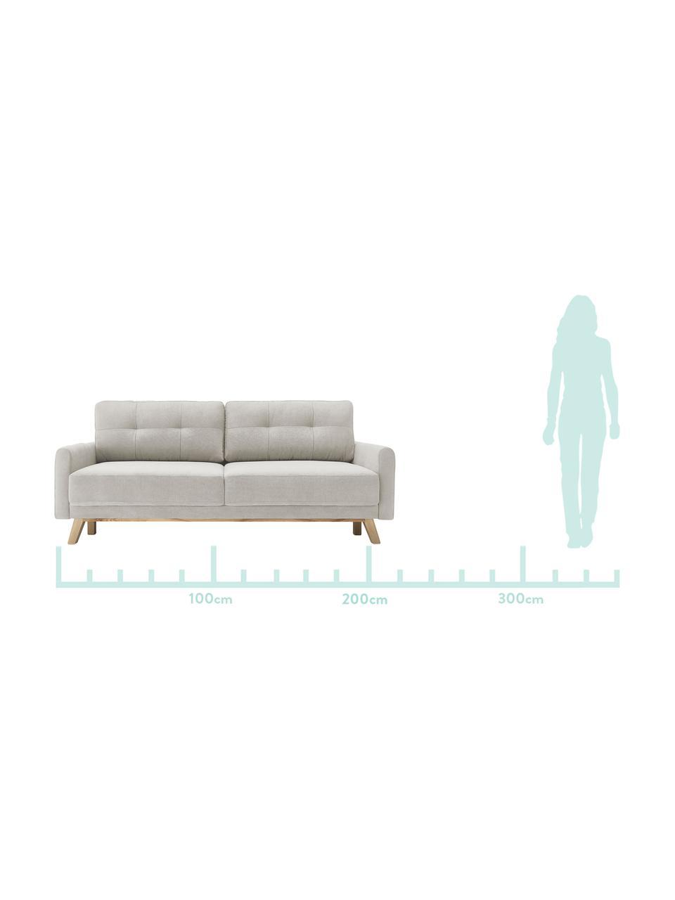 Sofa z aksamitu z funkcją spania i schowkiem Balio (3-osobowa), Tapicerka: aksamit poliestrowy Dzięk, Nogi: drewno naturalne, Odcienie kremowego, S 216 x G 102 cm