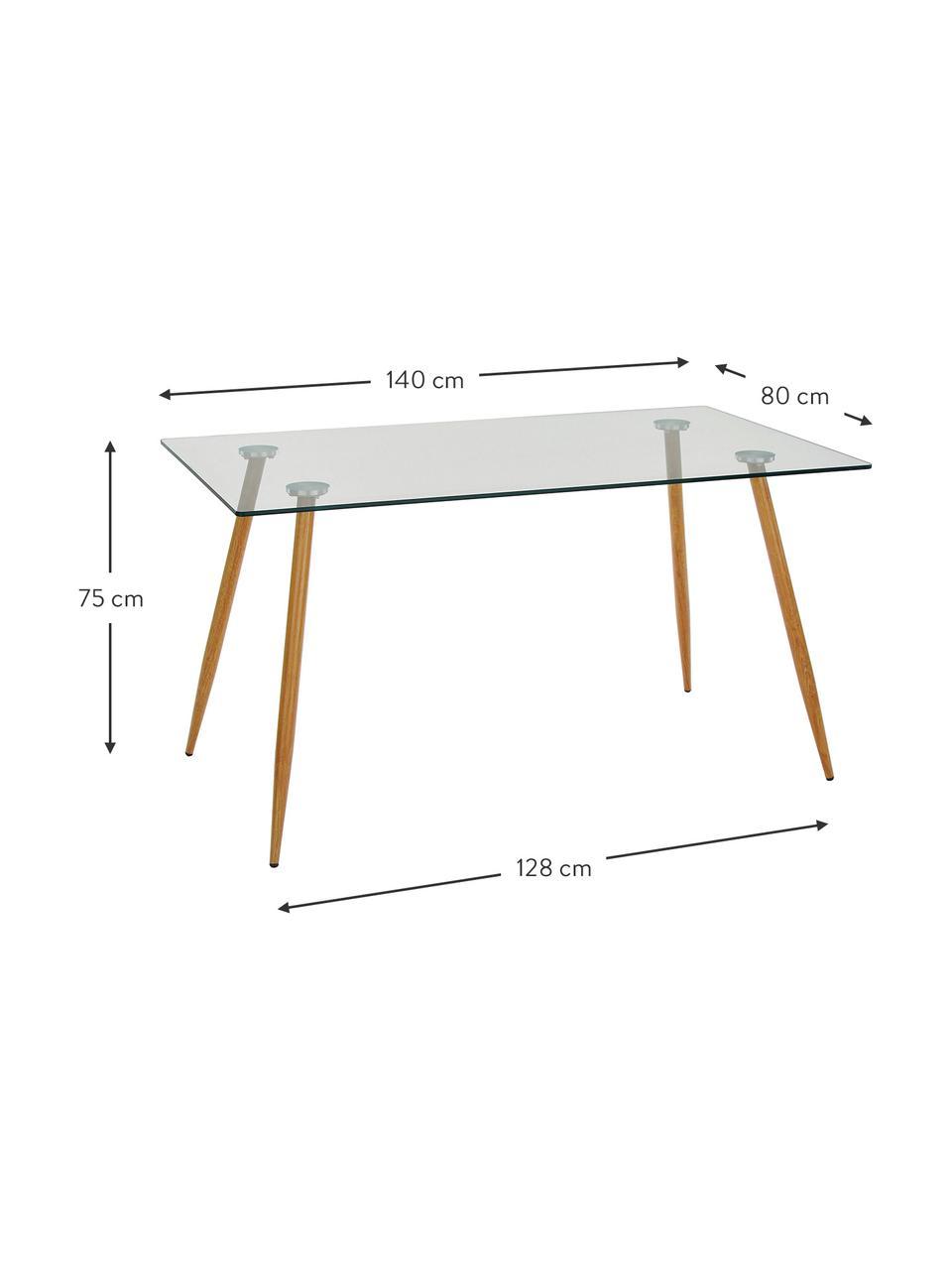 Stół do jadalni ze szkła z drewnianymi nogami Wilma, Blat: szkło hartowane, Nogi: metal malowany na kolor d, Blat: transparentny Mocowanie: srebrny Nogi: drewno dębowe, S 140 x G 80 cm