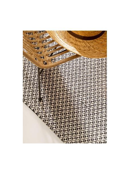 Handgeweven wollen vloerkleed Tolga in zwart/wit met rode kwastjes, 50% wol, 35% katoen, 15% nylon, Zwart, crèmewit, B 80 x L 150 cm (maat XS)