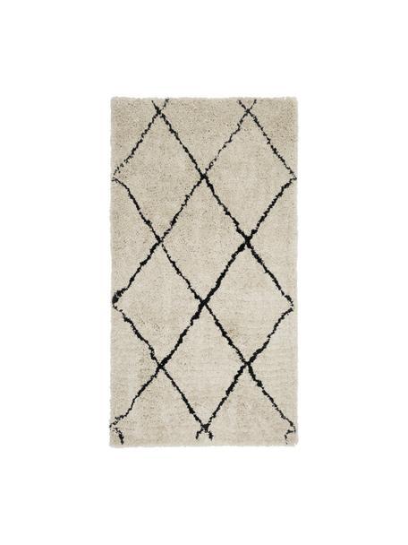 Pluizig hoogpolig vloerkleed Naima, handgetuft, Bovenzijde: 100% polyester, Onderzijde: 100% katoen, Beige, zwart, B 80 x L 150 cm (maat XS)